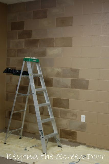 Painting concrete cinder blocks to look like stone blocks. Awesome idea! The colors used here are lovely.