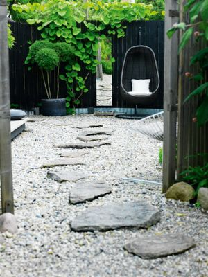 Love the stone path on top of the gravel! Also love that the path leads to a comfy chair in a little hideaway :-)