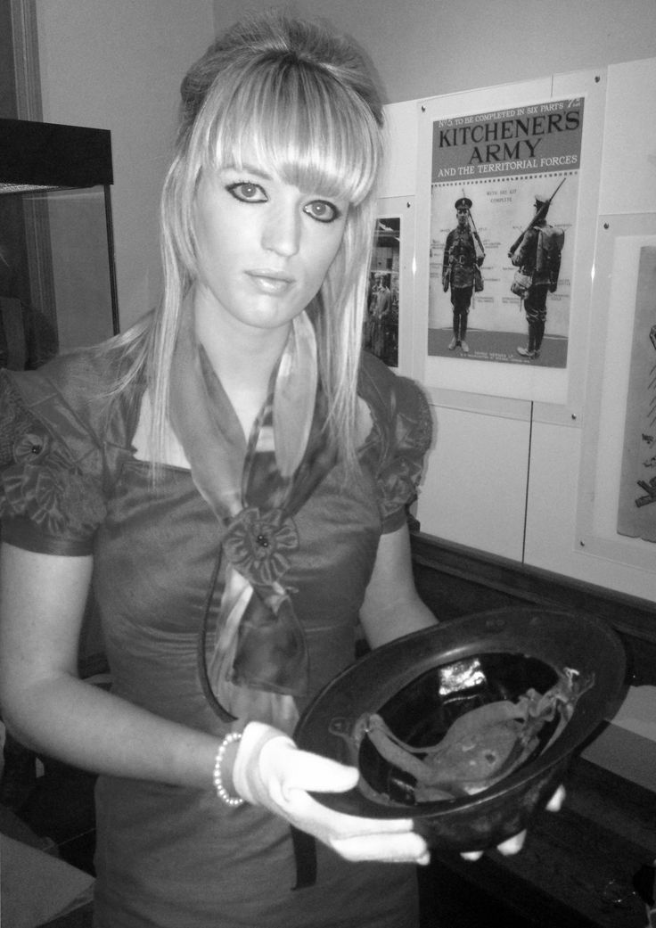 Photo shoot in the museum, my final outfit! Black and white photograph showing a British soldiers helmet from the Great War.