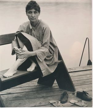 Alfred Stieglitz (1864 - 1946), Georgia O'Keeffe [Seated on Bench, Feet Bare], 1930s. Gelatin silver print, 8 ¾ x 7 3/8 inches. Georgia O'Keeffe Museum.