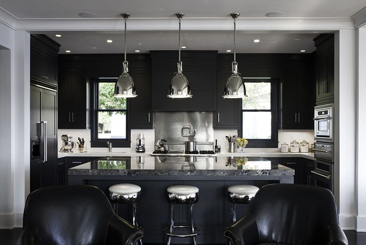 Go black on the kitchen cabinets – Below is a striking black small kitchen with stainless and silver accents. This works!
