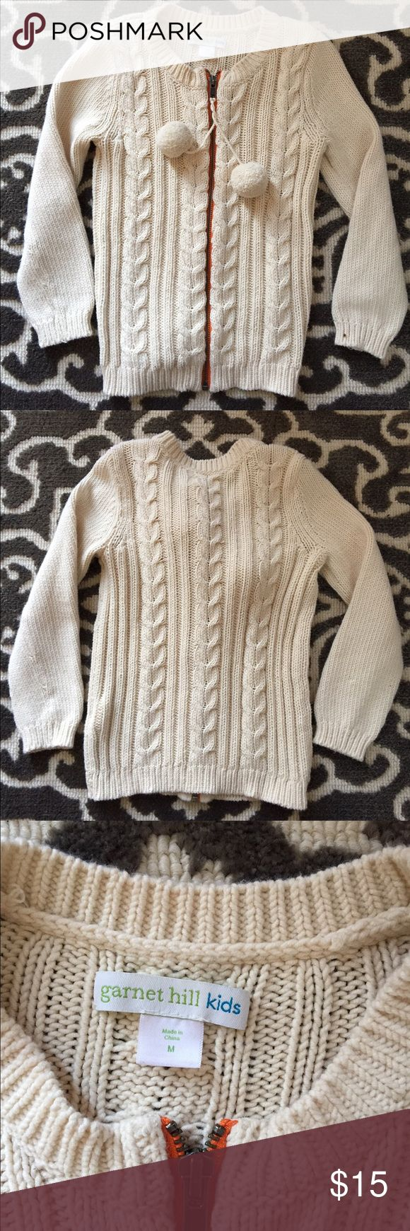 Garnet Hill Kids cream zip up sweater Super cute cream zip up sweater with poms. Kids size M - fits about 6-7. Excellent used condition Garnet Hill Kids Shirts & Tops Sweaters