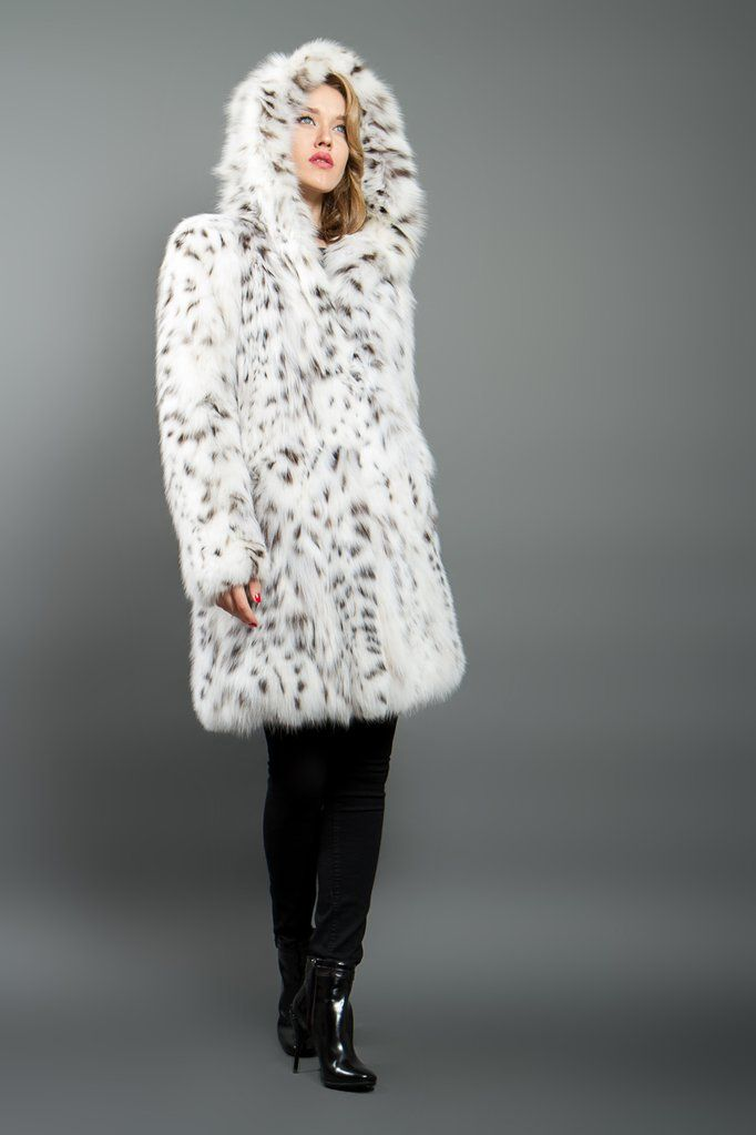 White Lynx coat made from natural white wild Canadian lynx fur. This model has vertical tailoring, full length sleeves, pockets, a hood. Designed and produced i