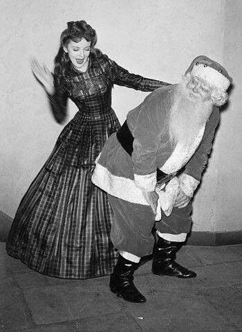Ida Lupino with Naughty Santa. Classic Hollywood Christmas