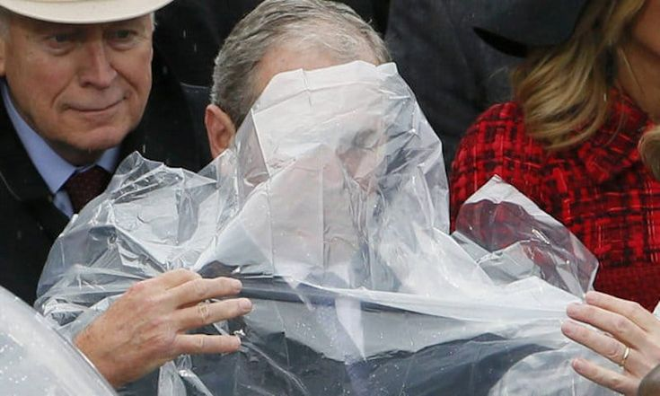 A LITTLE INAUGURATION HUMOR: George W. Bush Wrestling With His Rain Poncho (VIDEO) – American Lookout