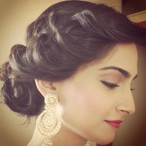 Graceful Sonam Kapoor in red lips and statement earrings. Love the hairstyle too!