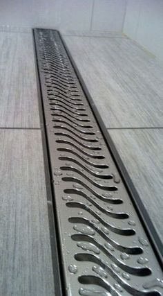Linear drains are the way to go to offer maximum drainage without standing on a small center drain or having the waste water pooling at the drain                                                                                                                                                                                 More