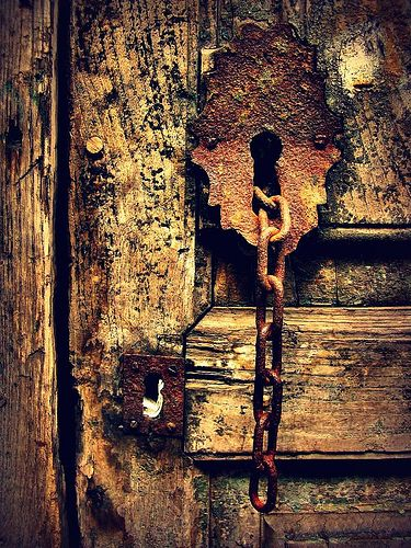 chain and wooden door