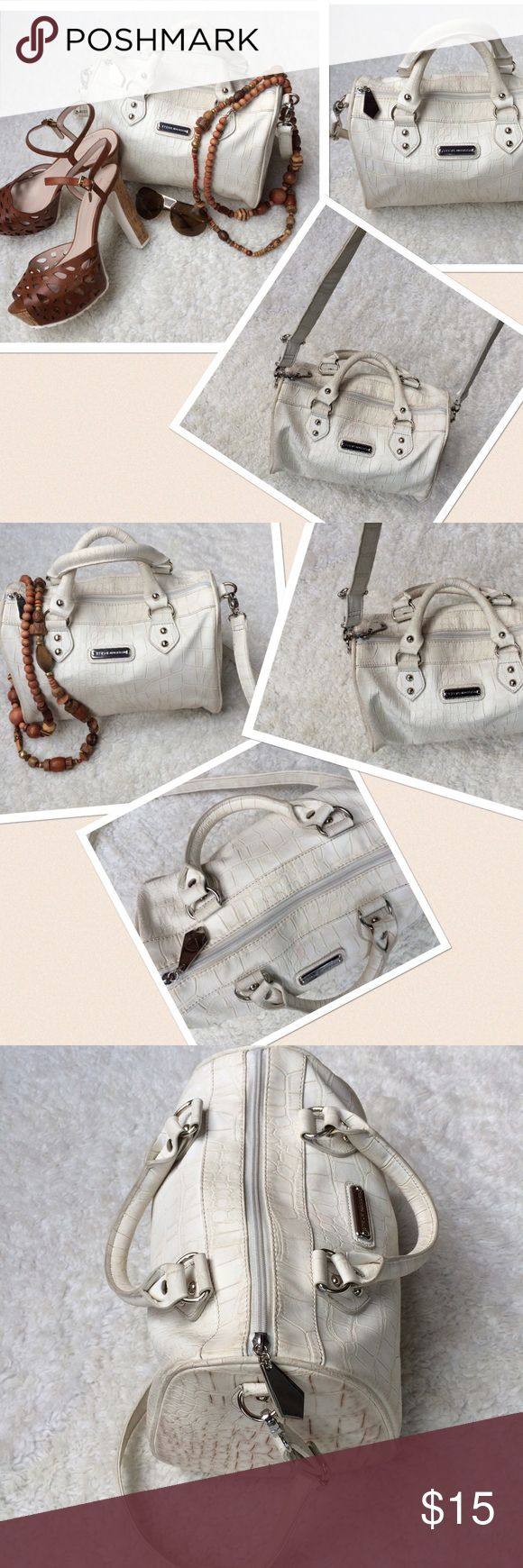"Steve Madden Croc Handbag Shoulder Doctor Bag Offwhite Croc design Handbag by Steve Madden. Designed with Shoulder Strap and Carry Handle. Logo at the front. Measures approximately: Shoulder strap: adjustable 18"" Carry Handle: 5"" Width: 11"" Length: 10"" Depth: 6"". Previously owned with ❤️. Has a small mark on the inside lining, nothing major, overall clean Excellent condition. Steve Madden Bags Shoulder Bags"