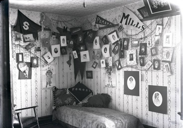 Vintage Dorm Decor: A draped fishing net backs this innovative gallery of photos and pennants in 1904.