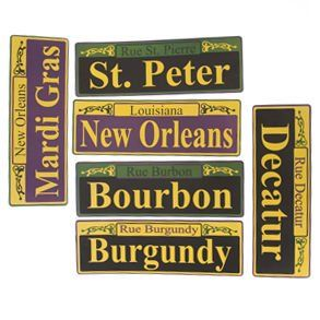 "Mardi Gras Street Signs by Century Novelty. $3.79. Wild and Crazy Mardi Gras Fun Starts with Decorations! The Mardi Gras Street Sign Cutouts are a great addition to any party. Just hang on door or wall for instant fun. Six street signs per package. 12"" long and 4"" wide. New Orleans street names printed on signs. Printed on one side. Put your guest in the Mardi Gras mood with Mardi Gras Party Decorations. Start the party off right and make your guest feel like they are in..."