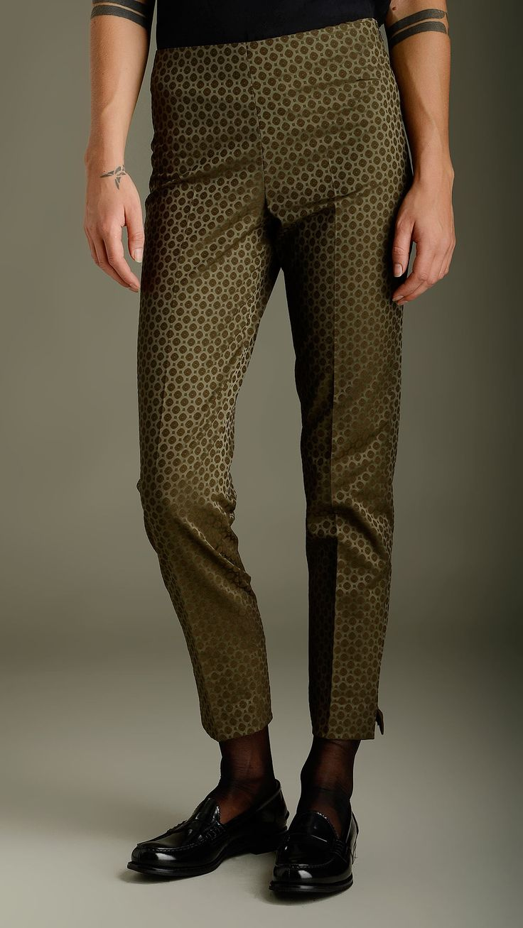 Embossed geometric pattern olive green pants in technical fabric featuring concealed side zip fastening, pocketless, side slit on the bottom, regular fit, 100% polyester.