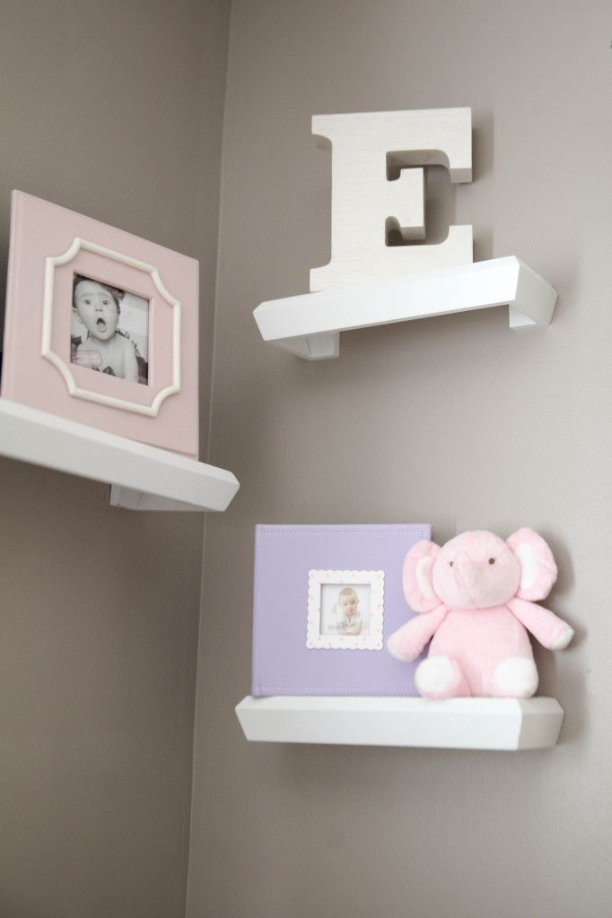 Corner shelves in the nursery - love the way these are stacked! #nurseryLilac Girl Nursery, Lilac Nursery Decor, Shelves In A Girls Nursery, Lilac Nursery Ideas, Nursery Lilac, Nursery'S 5, Corner Shelves Nursery, Project Nursery, Pink Taupe Nursery