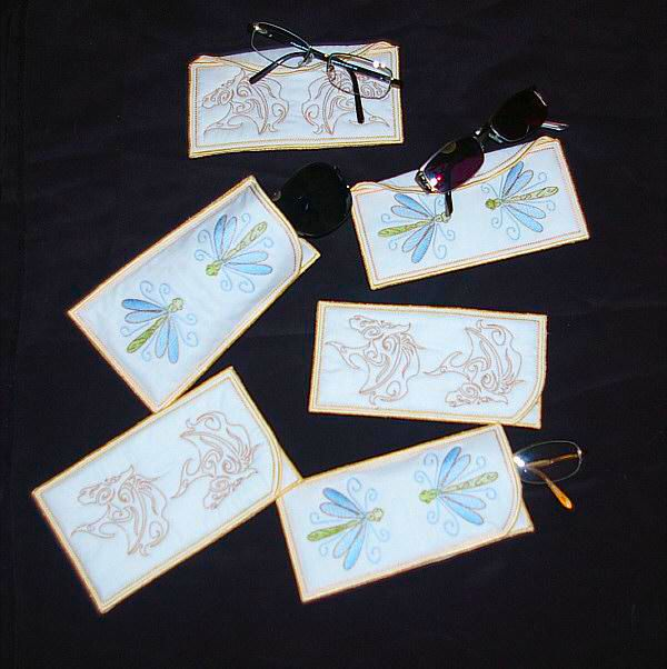 "In the Hoop ""Vision Combo"" includes designs to make two different eyeglass cases, one themed with dragonflies and one themed with horses! This is a great set to make cases for yourself or to gift to a friend! #EmbroideryDesigns  #Machine Embroidery  #Embroidery"