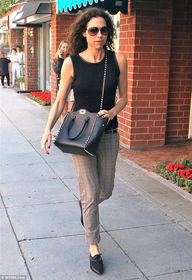 Minnie Driver with Valentino rock stud handbag