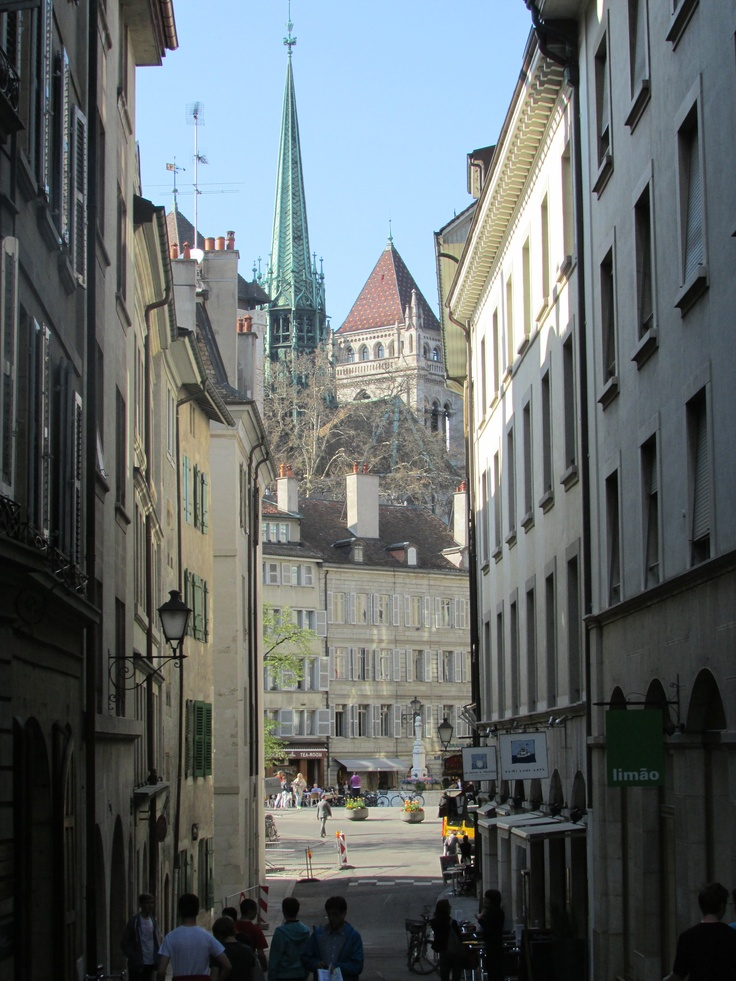 The Narrow Street - This photo is just bursting with culture and it can only we described as European! I love this photo because it is set in a small, narrow street which are typically seen in European countries and then you can just see the spire of the cathedral! I personally love the small alleys and streets! You can also see a part of the large square at the bottom!