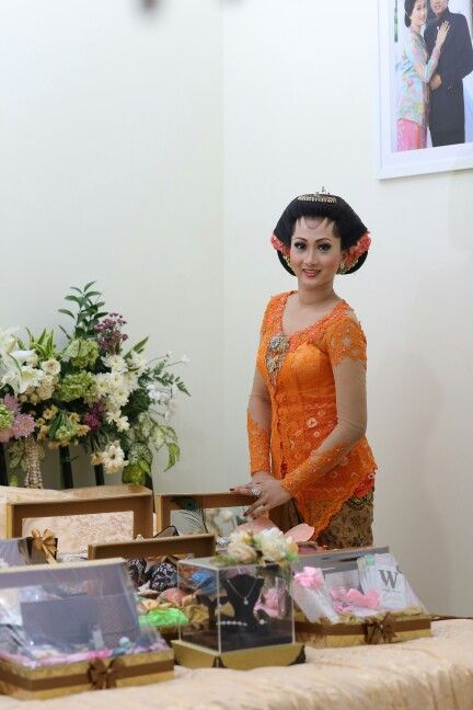The bride with 'peningset' or 'seserahan' from the groom in her room in midodareni night.