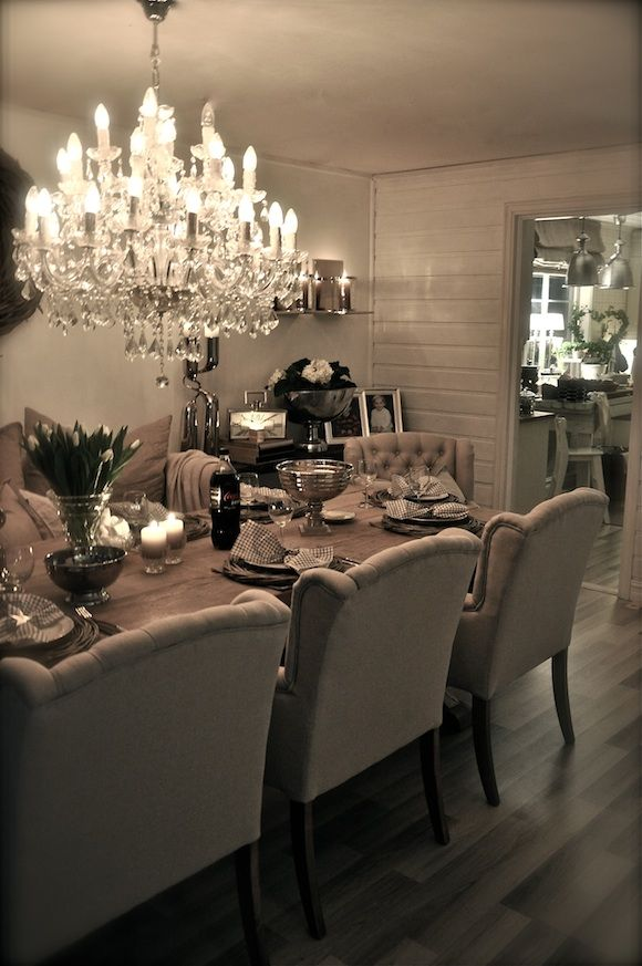 I'm in love with this dinning room. I would add a pop of color though. But those are the dinning room chairs I want.