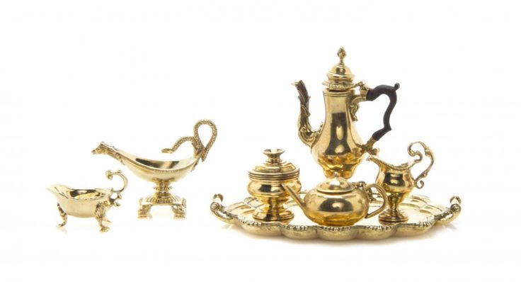 A Set of 18 Karat Yellow Gold Table Articles based on American Colonial and Federal examples, Peter Acquisto, comprising a three-piece coffee service and tray, by Obadiah Fisher, after a circa 1780 example by Myer Myers, New York, a sauce boat after a circa 1760-70 example by Paul Revere, Boston, and a sauce boat after a circa 1810 example by Anthony Rasch, Philadelphia, together with an associated teapot marked 14K; seven items total, approximate total weight of 18K examples 43.50 grams…