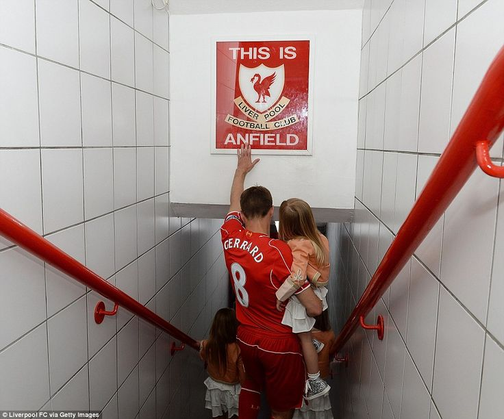 Last time: Liverpool FC's famous number eight touches the 'This is Anfield' sign in the st...