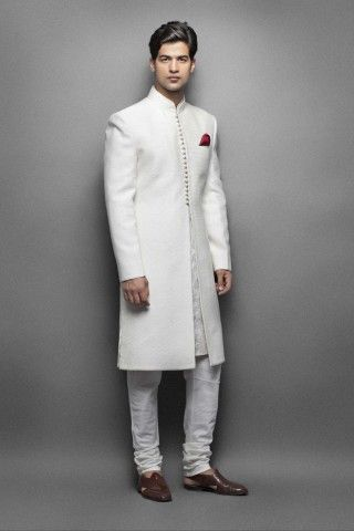 Cream silk sherwani paired with Gold Color kurta. I'm thinking white Sherwani with colored pants