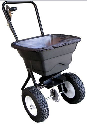 "Grass Seed Spreader - Walk Behind 80 lb Capacity - Spread Fertilizer for Lawn or Garden  Get our ""All Season Lawn Spreader"" the best price possible to get the job done right the first time. No more wasting money on those expensive lawn care products and time. With 80 pound of capacity you are ready no matter what the season. Spread seed and fertilizer in the spring and fall, lime in the summer..."