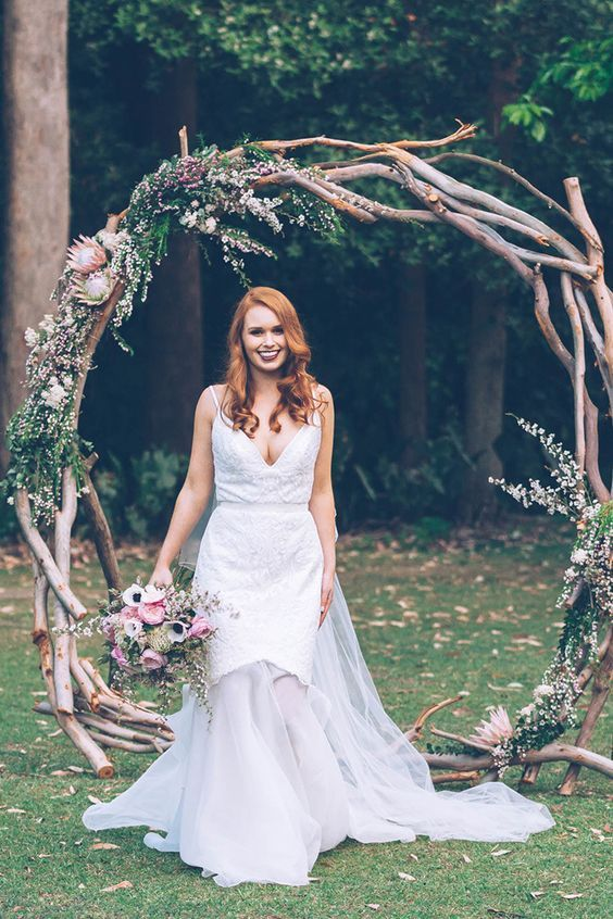 10 Giant Wedding Wreaths: The Hottest Wedding Trend: #8. Driftwood wreath topped with greenery, pink flowers and king proteas