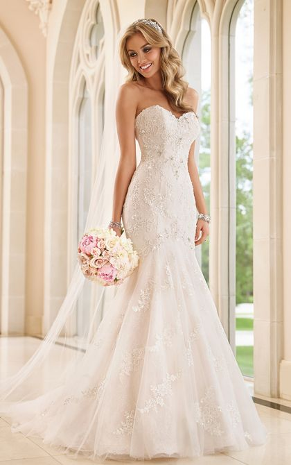 Dressed in spectacular beaded hand-placed Lace and enchanting Tulle, this Stella York sexy fit-and-flare wedding dress features beautiful Diamante crystals in a delicate floral pattern throughout. The strapless sweetheart bodice of this wedding dress frames your face, while the back zips up under sparkling crystal buttons and flows full into a modern train.