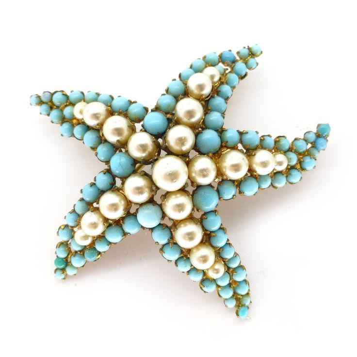 A charming 1950s starfish brooch set with faux pearls and turquoise glass stones. The brooch is finished with a secure roll over clasp. - The...