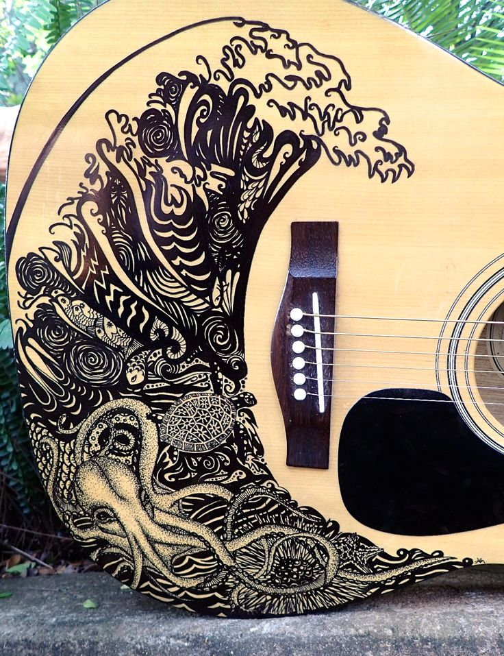 Sharpie guitar- Wave with sea creatures. Use a sharpie to decorate a guitar. Spray with clear lacquer afterwards to protect it.