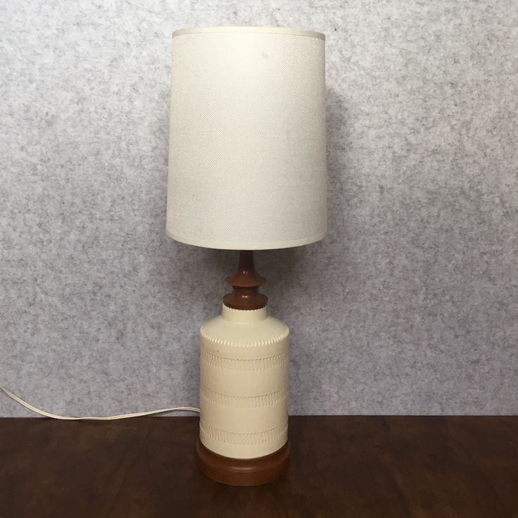 CREAM CERAMIC LAMP WITH TEAK BASE AND NECK - $75 AUD  Madecirca 1960s, this neutral cream ceramic table lamp features embossed ceramic detail,teak base and neck and an updated lamp shade.