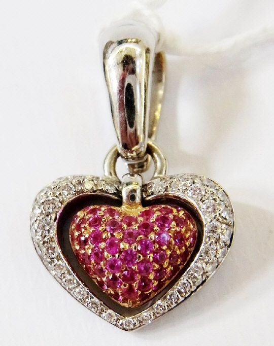 18ct gold Chimento diamond and pink sapphire heart pendant, having a pink sapphire set gold heart drop and diamond set heart surround. Estimate £800.00 to £1,000.00 (Lot no: 252 in sale on 05/08/2014) The Cotswold Auction Company