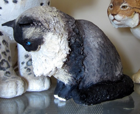 Last video in a series showing how to make a realistic cat sculpture with paper mache clay.