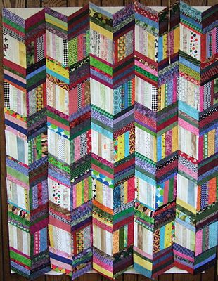 Scrap quilt blocks made with strips.