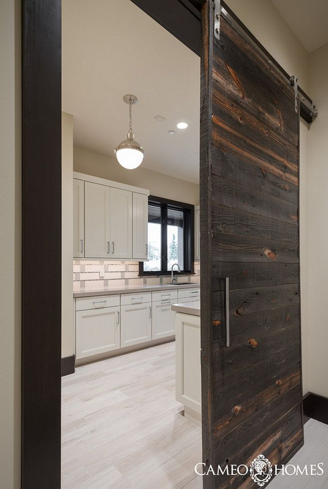 Laundry Room With A Sliding Barn Door Made Of Reclaimed