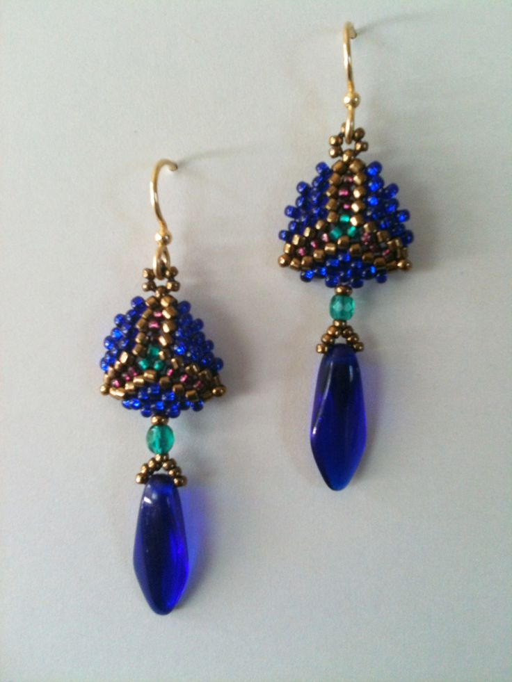 Cobalt, teal & purple triangle earrings by Jeka Lambert. Seed bead woven. Seed beads, glass beads. Available at the Volcano Art Center Gallery, Hawaii.