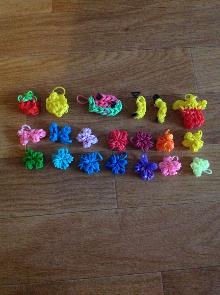 The crazy loom charms I made, french fries,banana,strawberry,bows ...