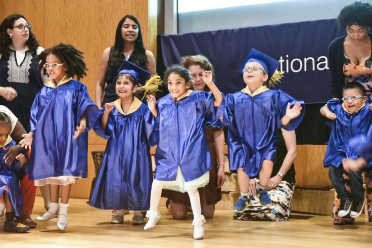 Graduates of Helen Keller Services for Blind Children's Learning Center dance on stage at Brooklyn's National Grid Auditorium on Friday.