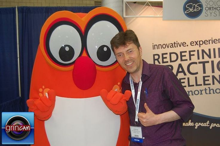 Dr Murray meets Smeethy the smiling monster at the American Orthodontics Conference