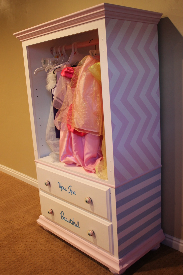 DIY Dress-up Cabinet, out of an old dresser.  Paint in boyish colors - because even boys have dress up clothes.  [no link, just idea]  Looks like the dresser we already have.