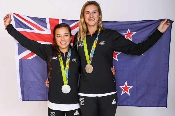 Molly Meech and Alex Maloney pose for a portrait with their Olympic Sailing Silver Medals (Getty Images)