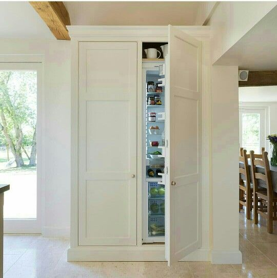 integrated with cupboard door taller than fridge