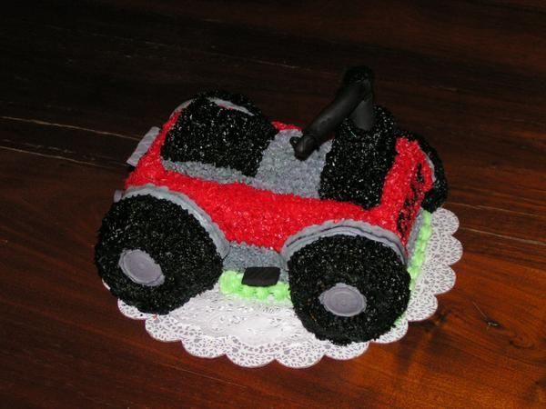 4-Wheeler - A 4-Wheeler cake that I did for my office managers son on his 15th bday. He is a 4-wheeler fanatic and had just gotten a new RED one for Christmas!