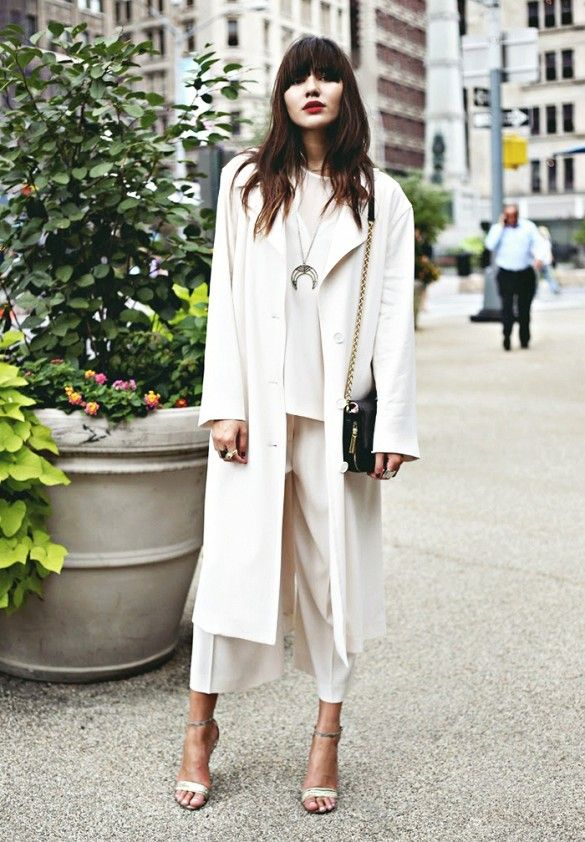Natalie Off Duty wearing an flowing all-white outfit with sleek sandals and a bold red lip