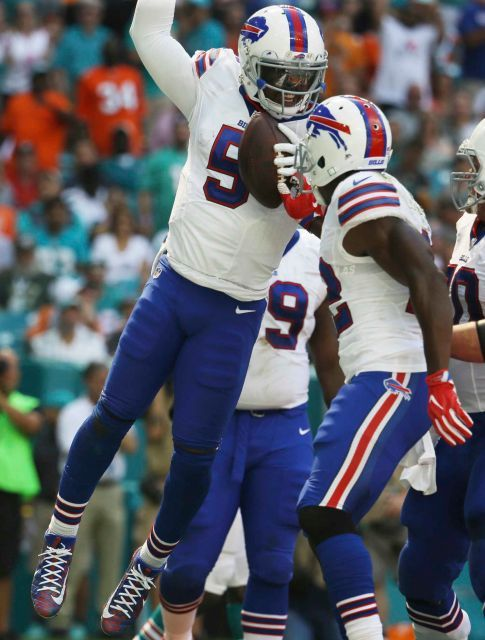 Bills vs. Dolphins:    October 23, 2016  -  28-25, Dolphins  -   Buffalo Bills quarterback Tyrod Taylor (5) celebrates his touchdown with running back Reggie Bush (22), during the first half of an NFL football game against the Miami Dolphins, Sunday, Oct. 23, 2016, in Miami Gardens, Fla.