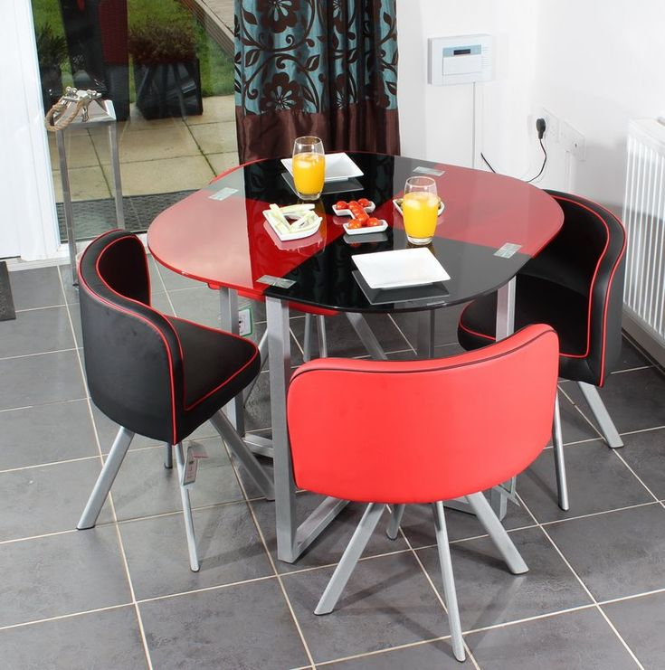 Slade Dining Set with 4 Chairs. This space saver dining table set is ideal for homes with limited dining space. The chairs sit directly underneath the dining table which is a great space saver. The elegant wide tempered glass table top is supported by powder coated metal legs which are eye-catching. Included in the space saver dining set are 4 stylish vinyl leather dining chairs which conveniently close in around the table making it space efficient and stylish.