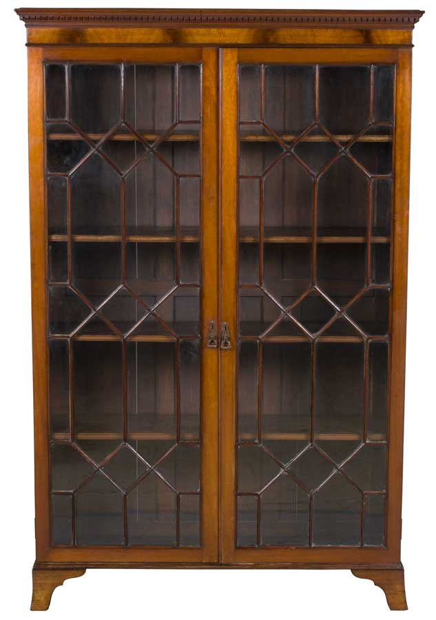 Antique Bookcase with Doors - English antique furniture, four adjustable shelves, locking doors with an intricate fretwork pattern.  Beautiful piece!