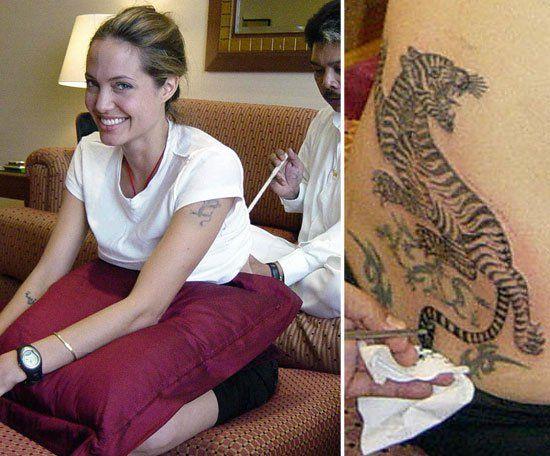 Pin for Later: Stars et Tatouages, une Grande Histoire D'amour  Angelina Jolie en train de se faire tatouer par le célèbre tatoueur thaïlandais Sompong Kanphai, à Bangkok en 2008.