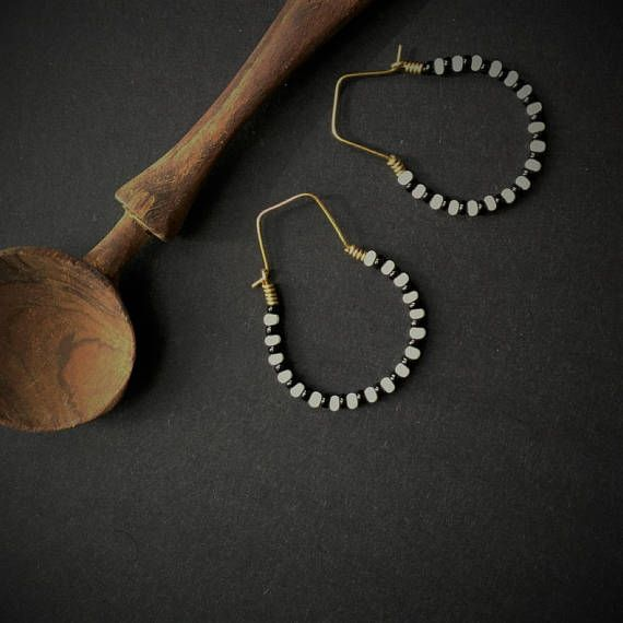 Very, very light. Classic hoop shape, with uniquely shaped earring wires. Earrings hang 4 cm (1.4 inches) from your piercing. 3 cm or 1.2 inches at widest point across the earring. This black and white combo adds a classic flair to your look. The small size works for the
