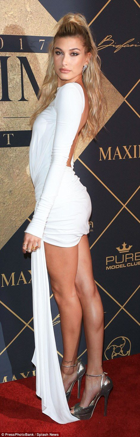 Backless: The 20-year-old model and daughter of Stephen Baldwin wore a revealing white mini dress that showed off her back
